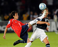 Chile win 1-0 over Argentina in their 2010 World Cup qualifying soccer match in Santiago, October 15, 2008.<br /> Chile player FABIAN ORELLANA and Argentine GABRIEL HEINZE.<br /> © Dupla / PikoPress