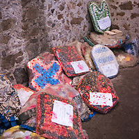 Wreaths and offerings left in memorial for slaves who lost their lives in the dungeons of Cape Coast Castle, a UNESCO World Heritage Site located along the Gold Coast of Ghana.