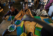 October 7, 2006 - Night commuter children paint at the Charity for Peace compound where children come for safety from possible abductions by the LRA in Gulu in north Uganda. Gulu is the main base for the Uganda Peoples Defense Force fighting the insurgent Joseph Kony's Lord's Resistance Army. Kony's LRA movement has been fighting for the past 20 years to force the East African country to be ruled according to the Christian Ten Commandments. Over 2 million people, mostly of the Acholi tribe, have moved or were forced to move from their villages to camps close to the towns of Gulu, Lira, and Kitgum where they are watched over by the Ugandan Army. The LRA rebels have abducted thousands of children and have forced them to fight against the Ugandan Army and the Acholi people. Current peace talks between Kony's LRA and the Ugandan government held in Juba, southern Sudan, offer a glimpse of hope to ending this ongoing conflict..(Photo by Jakub Mosur/Polaris)<br />