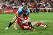 Ben Lucas is taken by Tom Kingston. Queensland Reds v NSW Waratahs. Investec Super Rugby Round 10 Match, 24 April 2011. Suncorp Stadium, Brisbane, Australia. Reds won 19-15. Photo: Clay Cross / photosport.co.nz