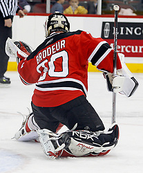 February 18, 2008; Newark, NJ, USA;  New Jersey Devils goalie Martin Brodeur (30) makes a glove save during the third period at the Prudential Center in Newark, NJ. The Devils beat the Hurricanes 5-1.