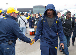 West Virginia players walk off the bus as they enters the stadium in Memphis, TN for the Liberty Bowl.