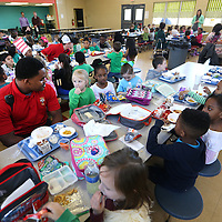 Adam Robison | BUY AT PHOTOS.DJOURNAL.COM<br /> Tupelo firefighers James Roberts, Sidney Jones and Justin Lamb, captain, eat lunch with students at ECEC on Friday. The Tupelo Fire Department has started a new program. The firemen on shift go eat lunch at lower elementary schools to give kids a chance to see firemen are their friends.