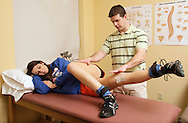 S.S. Seward girls' basketball player Sara Cannillo, who is recovering from surgery to repair the anterior cruciate ligament in her right knee, works with physical therapist Ray Youghhans at Access Physical Therapy & Wellness in Goshen on Monday, Feb. 14, 2011.