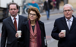 © Licensed to London News Pictures. 04/02/2013. London, UK. Economist Vicky Pryce (C) arrives at Southwark Crown Court in London today (04/02/13) at the start of a hearing where she faces charges of perverting the course of justice involving her ex-husband Chris Huhne and a 2003 speeding case. Photo credit: Matt Cetti-Roberts/LNP