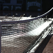 2017 French Open Tennis Tournament - The tennis net stands out against the waterered outside clay court at the end of the day in preparation for the 2017 French Open Tennis Tournament at Roland Garros on May 26th, 2017 in Paris, France.  (Photo by Tim Clayton/Corbis via Getty Images)