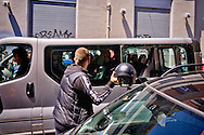 ROME, ITALY – MAY 21: Assaulted on Via Bixio  by a group of anti-fascists a minivan  with inside an alleged  band nazirock waiting at the  Colle Oppio for a concert for  the rally the far-right party Casapound, destroyed  vehicle glasses with helmet on May 21, 2016 in Rome, Italy.