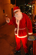 Israel, Haifa, Wadi Nisnas, young man dressed up as Santa Claus during the Holiday of holidays festival, celebrating Hanuka-Christmas-Ramadan festival in the Haifa Neighbourhood of Wadi Nisnas