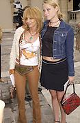 Kiera Chaplin and Rosanna Arquette. Christian Dior couture show. Ecole Nationale Superiore des Beaux- Arts. Paris. 7 July 2001. © Copyright Photograph by Dafydd Jones 66 Stockwell Park Rd. London SW9 0DA Tel 020 7733 0108 www.dafjones.com