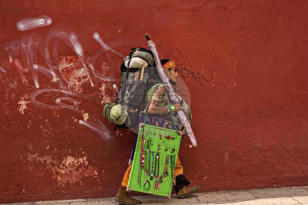 An itinerant craftsman selling handmade jewelry in Oaxaca, Mexico.