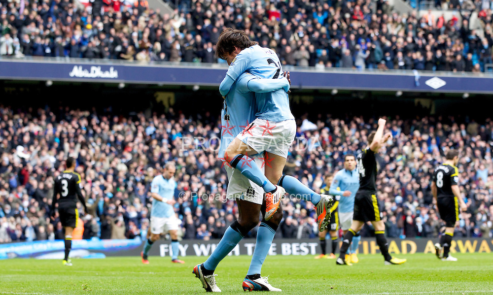 MANCHESTER, ENGLAND - Sunday, February 24, 2013: Manchester City's Yaya Toure celebrates scoring the first goal against Chelsea with team-mate David Silva during the Premiership match at the City of Manchester Stadium. (Pic by Vegard Grott/Propaganda)