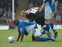 Photo: Ian Hebden.<br />Chesterfield United v Swansea City. Coca Cola League 1. 14/10/2006.<br />Chesterfields Reuben Hazell (L) tangles with Swanseas Andy Robinson (R).