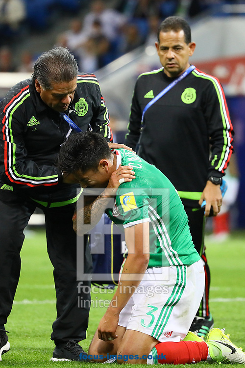Carlos Salcedo of Mexico injures his shoulder and is carried off the field during the 2017 FIFA Confederations Cup match at Fisht Stadium, Sochi<br /> Picture by EXPA Pictures/Focus Images Ltd 07814482222<br /> 22/06/2017<br /> *** UK &amp; IRELAND ONLY ***<br /> <br /> EXPA-EIB-170622-0059.jpg