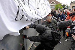 © Licensed to London News Pictures. 04/09/2014. Bristol, UK.  Protesters try to break through the police steel barrier by Celtic Manor, at the protest march through Newport against the NATO summit being held at The Celtic Manor resort at Newport. Photo credit : Simon Chapman/LNP