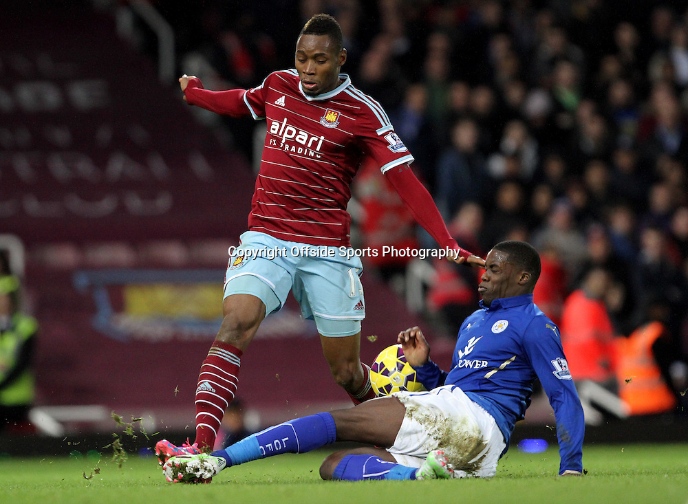 20 December 2014. Premiership. West Ham v Leicester.<br /> Jeffrey Schlupp of Leicester slides in to try and take the ball from Diafra Sakho. <br /> Photo: Charlotte Wilson