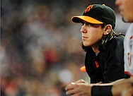 Apr. 17 2011; Phoenix, AZ, USA; San Francisco Giants pitcher Tim Lincecum (55) reacts from the dugout while playing against the Arizona Diamondbacks at Chase Field. The Diamondbacks defeated the Giants 6-5 in extra innings. Mandatory Credit: Jennifer Stewart-US PRESSWIRE..