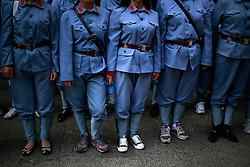 Different footwear are seen on Chinese communist party course trainees dressed in Red Army uniforms at the Jinggangshan Cemetery for Revolutionary Martyrs in Jinggangshan of Jiangxi Province, China, 14 October 2012. Jinggangshan or Jinggang mountain is a popular destination for Red Tourism where Chinese communist party cadres and ordinary Chinese tourists alike converge, seeking to relive the experiences and rekindle the spirit of the revolutionaries. It is deemed as the birthplace of the Chinese Red Army and the 'cradle of the Chinese revolution' which saw Communist leader Mao Zedong's ascent to power as a revolutionary. After a failed uprising in 1927, Mao fled into the mountains with his 1,000 remaining troops from nationalist forces and set up base here to reorganize his army, eventually defeating the Kuomingtang (KMT) to rule the country. Cadres dressed in Red Army uniforms attending Communist party training courses in are a common sight in the various historical sites of the mountain where they sing red songs and retrace the paths taken by their forbears. The Chinese communist party is slated to hold its 18th national congress on 08 November where a major leadership transition will see current leaders President Hu Jintao and Premier Wen Jiabao make way for a new generation of leaders helmed by Xi Jinping, With more than 80 million members, the Chinese Communist Party is hard pressed to display a show of unity and power after  scandals the ousting of disgraced politician Bo Xilai roiled the country. .