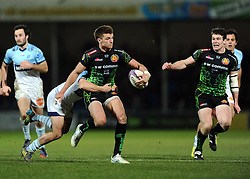 Exeter Chiefs' Fly Half, Henry Slade is tackled  - Photo mandatory by-line: Joe Meredith/JMP - Mobile: 07966 386802 - 24/01/2015 - SPORT - Rugby - Exeter - Sandy Park Stadium - Exeter Chiefs v Bayonne - Challenge Cup Round 6