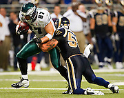 ST. LOUIS, MO - SEPTEMBER 11:   Brent Celek #87 of the Philadelphia Eagles is tackled by James Laurinaitis #55 of the St. Louis Rams at the Edward Jones Dome on September 11, 2011 in St. Louis, Missouri.  The Eagles defeated the Rams 31 to 13.  (Photo by Wesley Hitt/Getty Images) *** Local Caption *** Brent Celek; James Laurinaitis