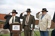 Vernon Ortenzi, A Troop; Loel Ewart, A Troop and Ed Arthur, B and D Troops salute during a rededication ceremony of the 9th Cavalry Monument at Motts Military Museum during the Gathering of Warriors reunion attended by Vietnam War Veterans of the 1st Squadron, 9th Cavalry, 1st Cavalry Divison.