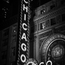 Chicago Theatre sign in black and white at night. The Chicago Theatre is a Chicago Landmark and is listed with the National Register of Historic Places.