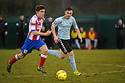 Dorking Wanderers Daniel Mahony makes a break from Lewes FC Dan Perry during the Ryman League - Div One South match between Dorking Wanderers and Lewes FC at Westhumble Playing Fields, Dorking, United Kingdom on 28 January 2017. Photo by Jon Bromley.