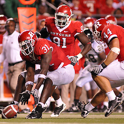 Sep 19, 2009; Piscataway, NJ, USA; Rutgers defensive end George Johnson (31) picks up a fumble during the second half of Rutgers' 23-15 victory over Florida International at Rutgers Stadium. The play  would be called an incomplete pass.