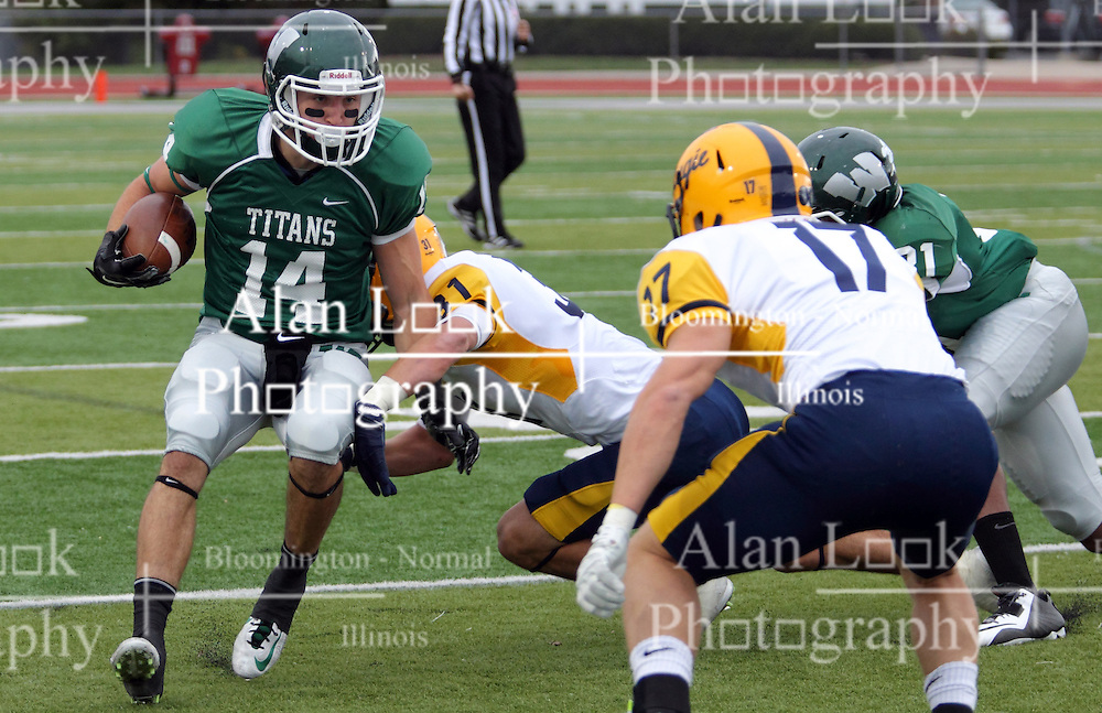 18 October 2014:  Artie Checchin tries to shake off Bo Goshorn during an NCAA division 3 football game between the Augustana Vikings and the Illinois Wesleyan Titans in Tucci Stadium on Wilder Field, Bloomington IL