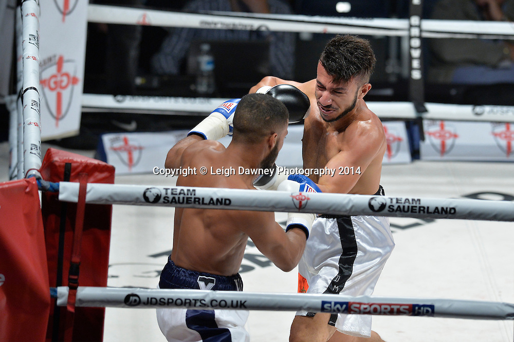 Gamal Yafai (blue/white gloves) defeats Sofiane Bellahcene in a Featherweight contest at the SSE Wembley Arena, London on the 20th September 2014. Sauerland Promotions. Credit: Leigh Dawney Photography.