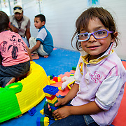 Abd al Qader, 5, from Daraa, Syria, enjoys playing with Legos at a Mercy Corps child friendly space in Azraq camp for Syrian refugees in Jordan, May 2014.