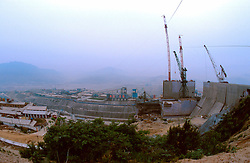 CHINA HUBEI PROVINCE THREE GORGES DAM MAY99 - A view on the construction site of the Three Gorges Dam. Seven large cities, including Chongquing, and thousands of villages will be submerged once the water level rises after the completion of the controversial Three Gorges Dam project further downriver. The flooding of areas reaching back more than 550Km upriver will require the evacuation and resettlement of more than 10 million people.  jre/Photo by Jiri Rezac. . © Jiri Rezac 1999. . Tel:   +44 (0) 7050 110 417. Email: info@jirirezac.com. Web:   www.jirirezac.com. © Jiri Rezac 1999. . Contact: +44 (0) 7050 110 417. Mobile:  +44 (0) 7801 337 683. Office:  +44 (0) 20 8968 9635. . Email:   jiri@jirirezac.com. Web:     www.jirirezac.com