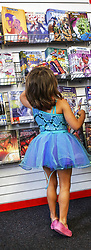 May 4, 2019 - Cincinnati, Kentucky, USA - Five year old  Bree Myers  looks over Comic Book for Comic books with woman flyers  in them  at Rocking Rooster Comic and Game shop .  On Sat May 4 2019 on Free Comic Book Day. Were you can get 3 some of the New Books this day. (Credit Image: © Ernest Coleman/ZUMA Wire)