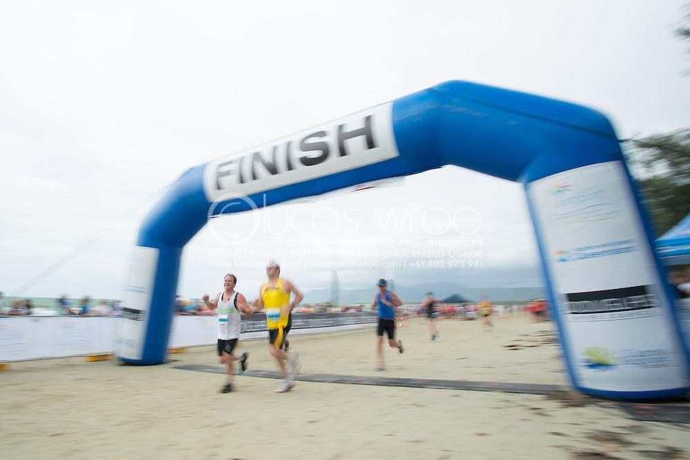 Age Group Competitors finish, June 1, 2014 - TRIATHLON : Coral Coast 5150 Triathlon, Cairns Airport Adventure Festival, Four Mile Beach, Port Douglas, Queensland, Australia. Credit: Lucas Wroe