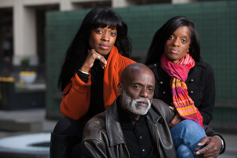 """New York, NY - November 05, 2013 : Veteran Scott Riley with his daughters Libra Riley-Johnson, left, and Hasha Riley, right, at the New York City Vietnam Veterans Memorial Plaza in New York, NY on November 05, 2013. Vet Scott Riley spent 30 years after her came back from Vietnam as a drug addict. Then he got clean and wrote a book--""""Grace in the Wilderness"""" with his two daughters."""