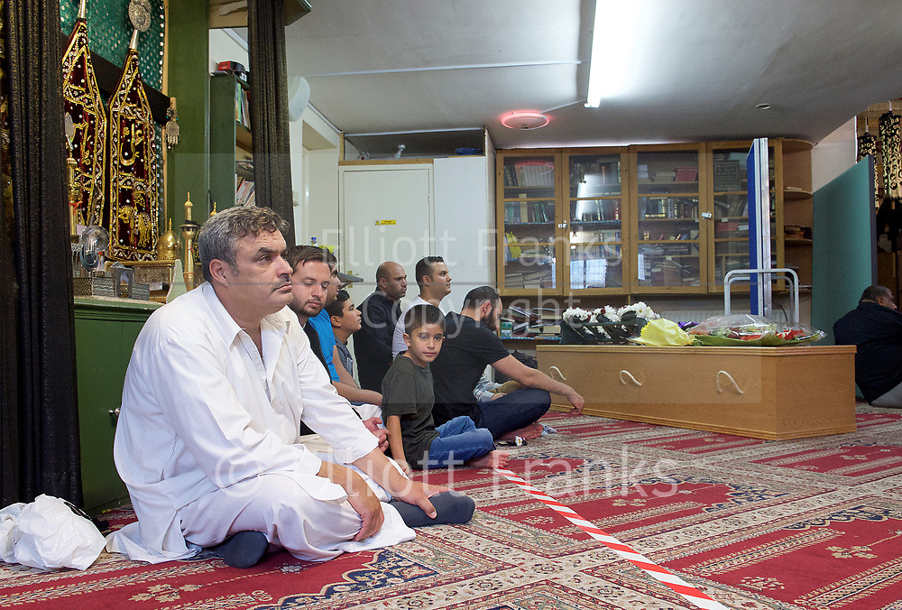 Ali Jafari's funeral prayers  <br /> Mr Ali Jafari, aged 82,  died following the fire at Grenfell Tower,<br /> 14th July 2017 <br /> <br /> Prayers at the Hussaini Islamic Mission, Thornbury Road, Isleworth, <br /> <br /> The cortege departing  from the Hussaina Islamic Mission <br /> <br /> Mr Jafari's three sons and family sit around the coffin which was placed at the back of the mosque <br /> <br /> Bashir Jafari <br /> <br /> Hamid Jafari <br /> <br /> Farid Jafari <br /> <br /> <br /> Photograph by Elliott Franks <br /> Image licensed to Elliott Franks Photography Services