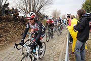 Belgium, March 31 2013: The second group over the Oude Kwaremont on the first pass included Edvald Boasson Hagen, Sky Procycling (in red jersey) during the elite men's edition of the Ronde van Vlaandaren 2013 cycle race. Copyright 2013 Peter Horrell.