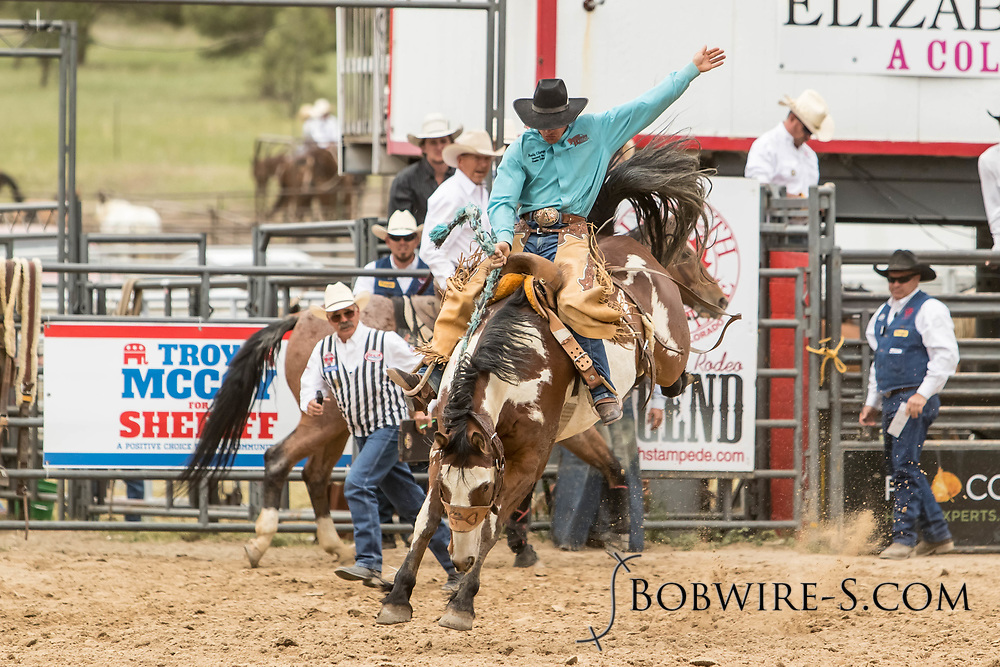 Saddle brond rider Andy Clarys rides Summit Pro Rodeo's Big Wig during the third performance of the Elizabeth Stampede on Sunday, June 3, 2018.