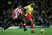 Photo: Marc Atkins.<br /> Watford v Sheffield United. The Barclays Premiership. 28/11/2006. Danny Shittu (R) of Watford &  Mikele Leigertwood of Sheffied Utd in action.