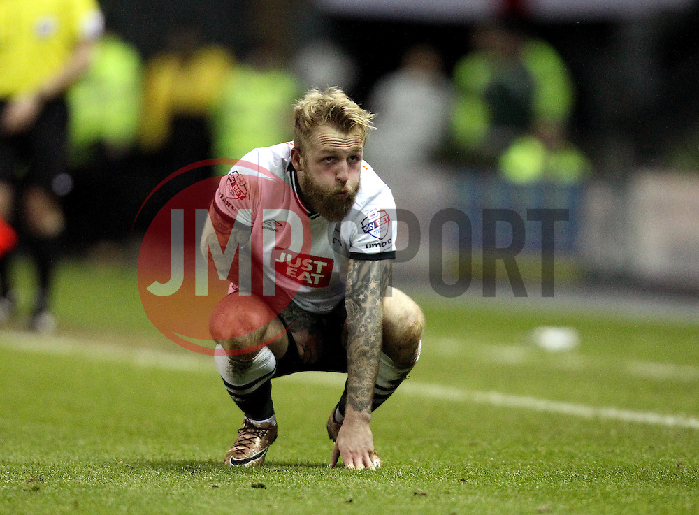 Johnny Russell of Derby County holds a delicate area after taking a ball to his body - Mandatory byline: Robbie Stephenson/JMP - 12/01/2016 - FOOTBALL - iPro Stadium - Derby, England - Derby County v Reading - Sky Bet Championship
