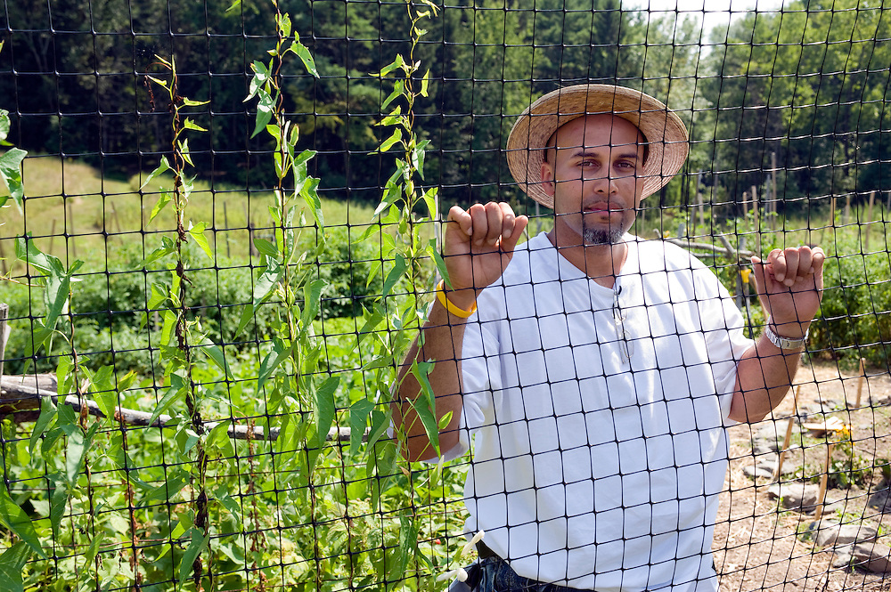 "Carlos Rosario in the garden at Bard College in Annandale-on-Hudson, New York. He helped creating it after his release from prison in May 2010...Story: The Bard Prison Initiative.Former inmate Carlos Rosario, 35-year-old husband and father of four, was released from Woodbourne Correctional Facility after serving more than 12 years for armed robbery. Rosado is one of the students participating in the Bard Prison Initiative, a privately-funded program that offers inmates at five New York State prisons the opportunity to work toward a college degree from Bard College. The program, which is the brainchild of alumnus Max Kenner, is competitive, accepting only 15 new students at each facility every other year. .Carlos Rosario received the Bachelor of Arts degree in social studies from the prestigious College Saturday, just a few days after his release. He had been working on it for the last six years. His senior thesis was titled ""The Diet of Punishment: Prison Food and Penal Practice in the Post-Rehabilitative Era,"".Rosado is credited with developing a garden in one of the few green spaces inside the otherwise cement-heavy prison. In the two years since the garden's foundation, it has provided some of the only access the prison's 800 inmates have to fresh vegetables and fruit...Rosario now works for a recycling company in Poughkeepsie, N.Y...Photo © Stefan Falke"
