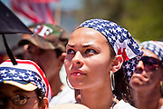 May 29 - PHOENIX, AZ: A woman with a US flag headband at a pro-immigrants rights rally in Phoenix Saturday. More than 30,000 people, supporters of immigrants' rights and opposed to Arizona SB1070, marched through central Phoenix to the Arizona State Capitol Saturday. SB1070 makes it an Arizona state crime to be in the US illegally and requires that immigrants carry papers with them at all times and present to law enforcement when asked to. Critics of the law say it will lead to racial profiling, harassment of Hispanics and usurps the federal role in immigration enforcement. Supporters of the law say it merely brings Arizona law into line with existing federal laws.  Photo by Jack Kurtz
