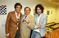 Left to right, OSCAR HUMPHRIES, BARRY HUMPHRIES and RUPERT HUMPHRIES at an exhibition of art by Oscar Humphries entitles 'Post-Nuclear Family' held at Nutters, Lower Ground, 12 Savile Row, London on 8th June 2006.<br />