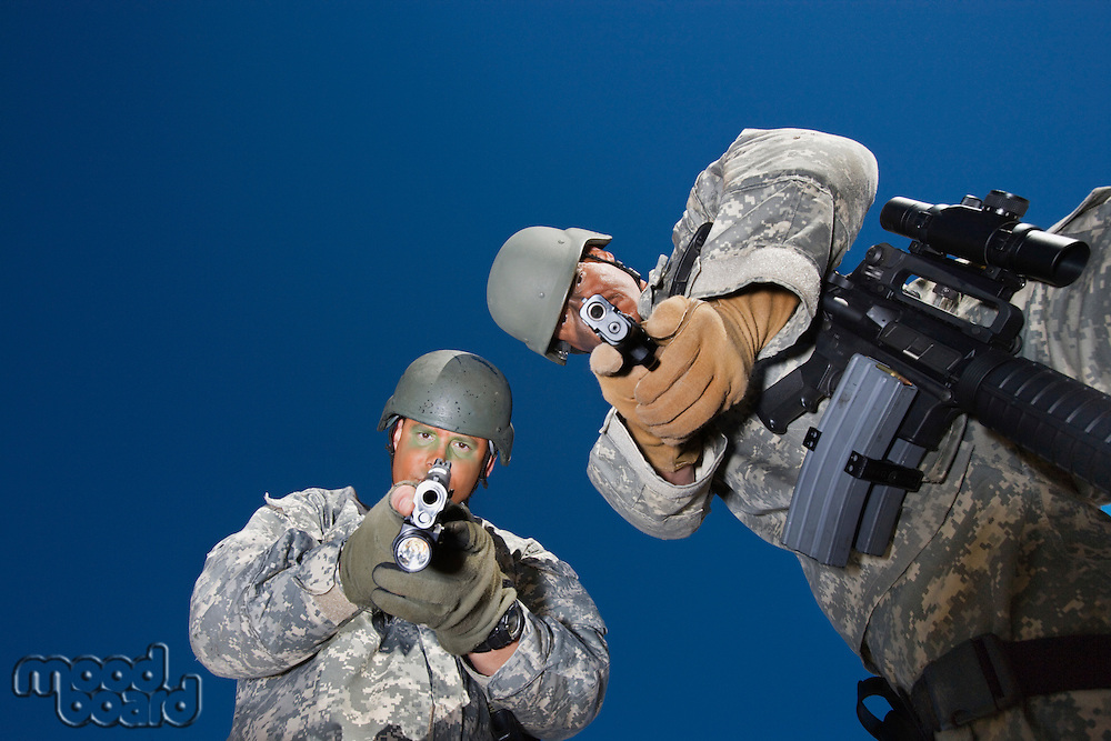 Portrait of two soldiers aiming to camera