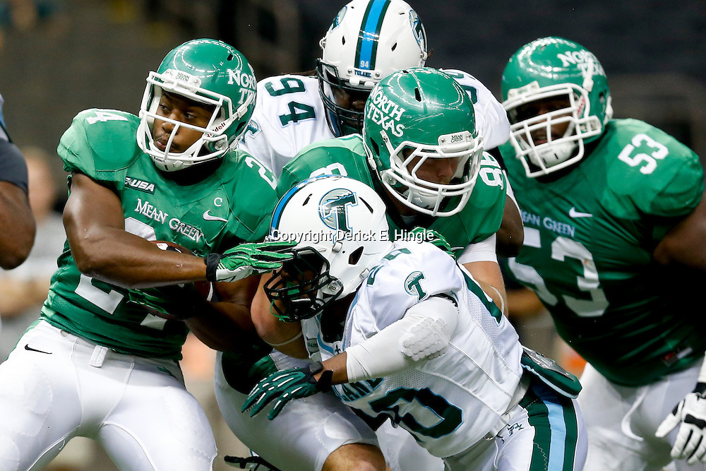 Oct 5, 2013; New Orleans, LA, USA; Tulane Green Wave linebacker Nico Marley (20) tackles North Texas Mean Green running back Brandin Byrd (24) during the first half at Mercedes-Benz Superdome. Tulane defeated North Texas 24-21. Mandatory Credit: Derick E. Hingle-USA TODAY Sports
