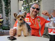 Ferrari owner with Yorkshire Terrier at Cavallino Palm Beach