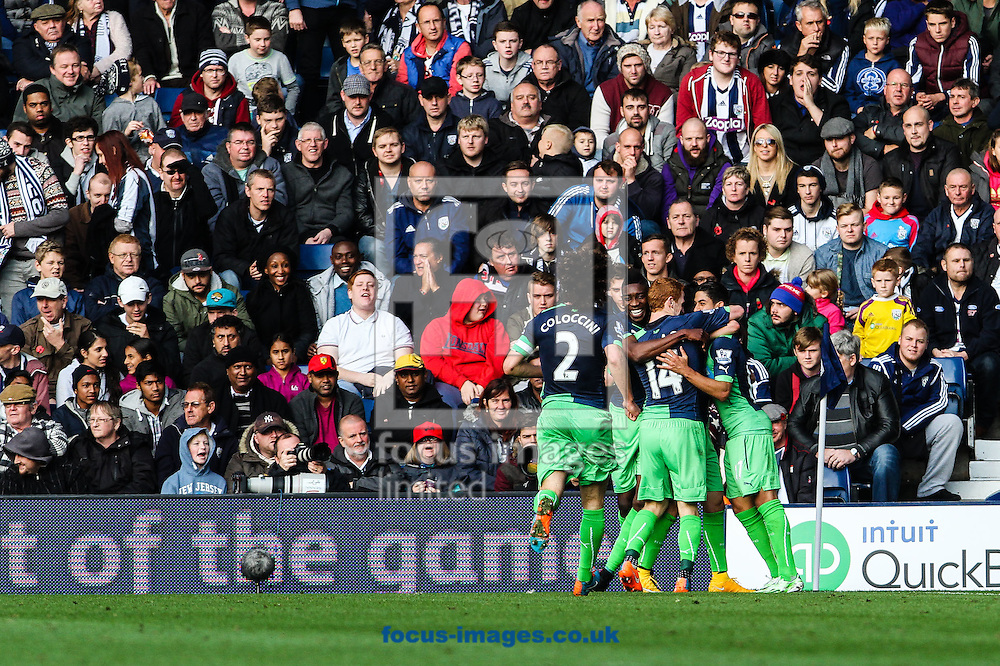 Newcastle players celebrate their first goal during the Barclays Premier League match at The Hawthorns, West Bromwich<br /> Picture by Andy Kearns/Focus Images Ltd 0781 864 4264<br /> 09/11/2014