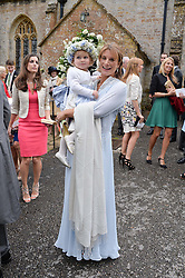 The Groom's sister the HON.SELINA HOPKINS and her daughter LILY HOPKINS at the wedding of Princess Florence von Preussen second daughter of Prince Nicholas von Preussen to the Hon.James Tollemache youngest son of the 5th Lord Tollemache held at the Church of St.Michael & All Angels, East Coker, Somerset on 10th May 2014.
