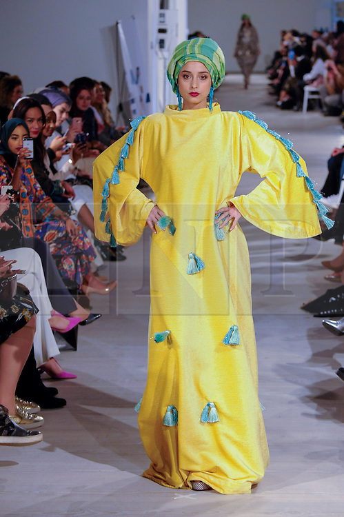 © Licensed to London News Pictures. 18/02/2017. London, UK.  A model presents a look by Tuhfah (Malaysia) at the UK's first London Modest Fashion Week taking place this weekend at the Saatchi Gallery.  The two day event sees 40 brands from across the world come together to showcase their collections for Muslim and other religious women. Photo credit : Stephen Chung/LNP