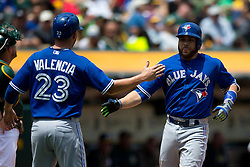 OAKLAND, CA - JULY 23:  Russell Martin #55 of the Toronto Blue Jays is congratulated by Danny Valencia #23 after hitting a two run home run against the Oakland Athletics during the second inning at O.co Coliseum on July 23, 2015 in Oakland, California. The Toronto Blue Jays defeated the Oakland Athletics 5-2. (Photo by Jason O. Watson/Getty Images) *** Local Caption *** Russell Martin; Danny Valencia