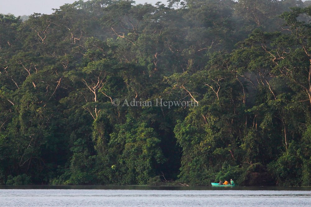 Tourist boat on natural rainforest canal in Tortuguero National Park. Costa Rica. October 2011.. We accept payments via PayPal.